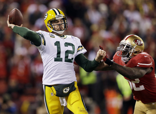 Fans still flock to the stadiums and their televisions to watch NFL stars like Green Bay Packers quarterback Aaron Rodgers (12) and 49ers linebacker Patrick Willis (52), but the league faces a host of issues during the upcoming offseason. (AP Photo/Marcio Jose Sanchez)