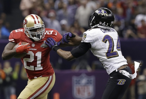 San Francisco 49ers running back Frank Gore (21) fends off Baltimore Ravens cornerback Corey Graham (24) as he runs with the ball during the second half of the NFL Super Bowl XLVII football game, Sunday, Feb. 3, 2013, in New Orleans. (AP Photo/Mark Humphrey)