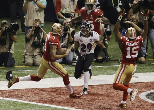 San Francisco 49ers quarterback Colin Kaepernick (7) runs the ball in for a 15-yard touchdown against the Baltimore Ravens during the second half of the NFL Super Bowl XLVII football game, Sunday, Feb. 3, 2013, in New Orleans. (AP Photo/Gerald Herbert)