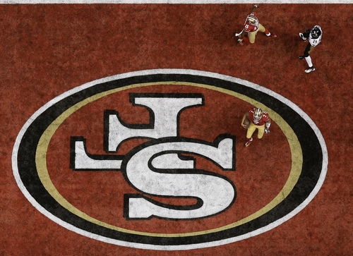 San Francisco 49ers quarterback Colin Kaepernick (7) celebrates after scoring on a 15-yard touchdown run during the second half of the NFL Super Bowl XLVII football game against the Baltimore Ravens, Sunday, Feb. 3, 2013, in New Orleans. (AP Photo/David J. Phillip)