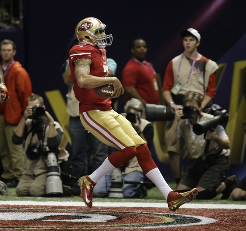 San Francisco 49ers quarterback Colin Kaepernick (7) scores a touchdown against the Baltimore Ravens during the second half of the NFL Super Bowl XLVII football game Sunday, Feb. 3, 2013, in New Orleans. (AP Photo/Matt Slocum)