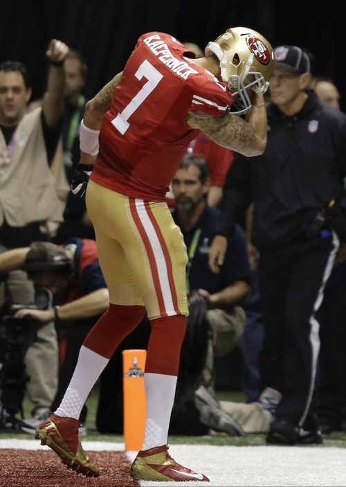 San Francisco 49ers quarterback Colin Kaepernick (7) celebrates after scoring a touchdown against the Baltimore Ravens during the second half of the NFL Super Bowl XLVII football game, Sunday, Feb. 3, 2013, in New Orleans. (AP Photo/Matt Slocum)