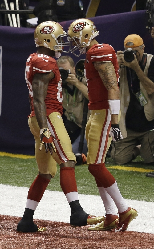 San Francisco 49ers quarterback Colin Kaepernick (7) celebrates with Vernon Davis (85) after rushing for a 15-yard touchdown during the second half of the NFL Super Bowl XLVII football game against the Baltimore Ravens, Sunday, Feb. 3, 2013, in New Orleans. (AP Photo/Gerald Herbert)