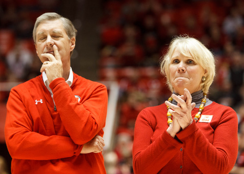 Trent Nelson  |  The Salt Lake Tribune Utah athletic director Dr. Chris Hill and Jodi Majerus (sister of former Utah basketball coach Rick Majerus) take in the moment as coach Majerus' sweater is retired into the rafters of the Huntsman Center, as Utah hosts Colorado, college basketball Saturday, February 2, 2013 in Salt Lake City.