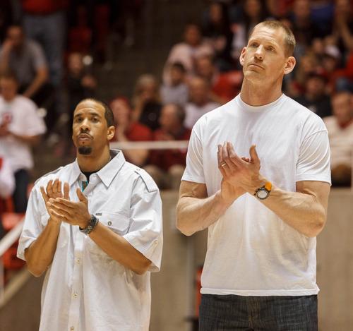 Trent Nelson  |  The Salt Lake Tribune Former Utah players Andre Miller and Michael Doleac applaud as former Utah coach Rick Majerus' sweater is retired. Utah hosts Colorado, college basketball Saturday, February 2, 2013 in Salt Lake City.