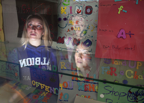 Steve Griffin | The Salt Lake Tribune   Albion Middle School counselor, Cathy Nelson, health teacher Jackie Kinihan and Maya Miyairi, a PH.D candidate at the Univeresity of Utah, are reflected in a glass case with posters made by students about bullying.  Miyairi conducted a anti-bullying study that she invented based on previous programs. She spent several weeks teaching her pilot program at the Sandy, Utah school.   Friday February 1, 2013.