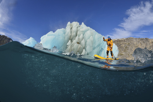 Mike Libecki of Cottonwood Heights does a little stand up paddleboarding while on an expedition in Antarctica in 2012. Courtesy of Keith Ladzinski