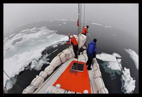 Clearing a path through the ice while while on an expedition in Antarctica in 2012. Courtesy Mike Libecki