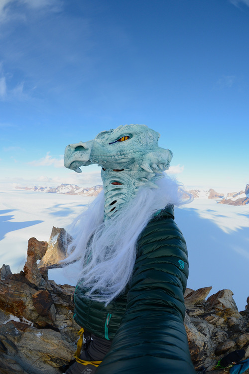 """Mike Libecki of Cottonwood Heights celebrates a first ascent in Antarctica and his """"Year of the Dragon"""" expeditions by wearing a dragon costume. Courtesy Mike Libecki"""