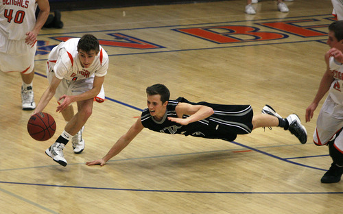 Scott Sommerdorf   |  The Salt Lake Tribune Brighton's Zach Bernardo dribbles away with a steal as Alta's Tanner Heyland dives to try to regain the ball during first half play. Alta led Brighton 34-25 at the half at Brighton High, Friday, February 1, 2013.