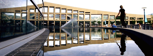 Steve Griffin  |  Tribune file photo The Crescent Wall at the Salt Lake City Main Library is reflected in a pool of water in 2003.