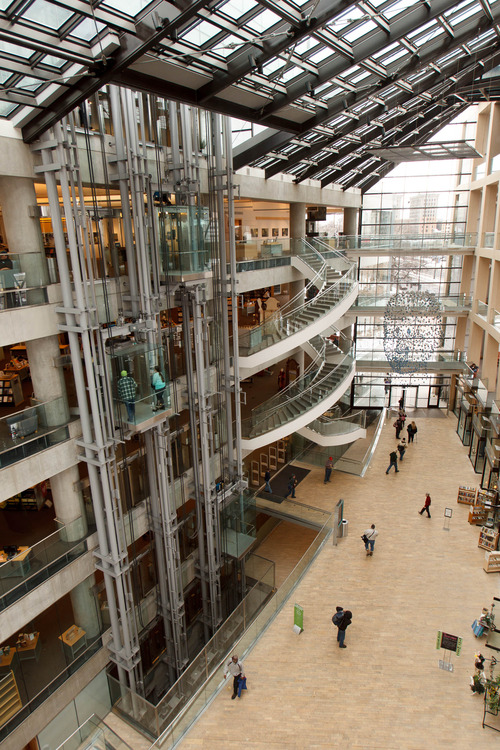 Trent Nelson  |  The Salt Lake Tribune The Main Library in Salt Lake City features glass elevators in its soaring atrium.