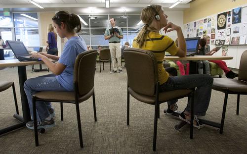 Steve Griffin | The Salt Lake Tribune   Nora Discuillo and Kendyl Baker use their netbooks as their seventh-grade english teacher, Ben Wheeler, teaches in the Centennial Junior High School library in Kaysville on Monday Nov. 19, 2012.