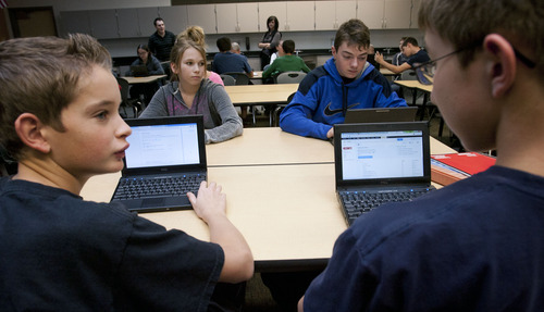 Steve Griffin | The Salt Lake Tribune   Students use their netbooks in Tyson Grover's Science Exploration class at Centennial Junior High School in Kaysville on Monday Nov. 19, 2012.