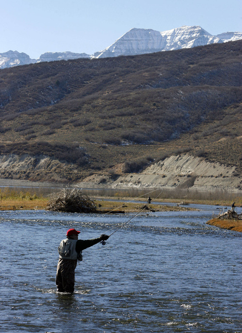 Al Hartmann | Tribune file photo A fisherman tries his luck on the Middle Provo River where it enters Deer Creek Reservoir, just south of Midway.