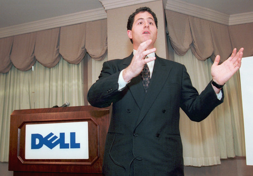 In this Thursday, Jan. 12, 1995, file photo, Michael Dell, chief executive officer of Dell Computer Corp., makes a point during a news conference in New York City. It's easy to forget now, but Michael Dell was the Mark Zuckerberg of his time. Hailed as a young genius, he created the inexpensive, made-to-order personal computer in his dorm room and peddled it to the masses, but now the PC is being eclipsed by smartphones and tablet computers, and Dell is trying to save his company. (AP Photo/Clark Jones)