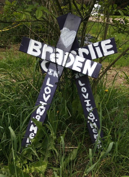 Rick Egan    The Salt Lake Tribune   Crosses with the names of Charlie and Braden were left near empty lot where the house once stood, in Puyallup, Wash., that Josh Powell set on fire with himself and his boys inside. Thursday, May 10, 2012.