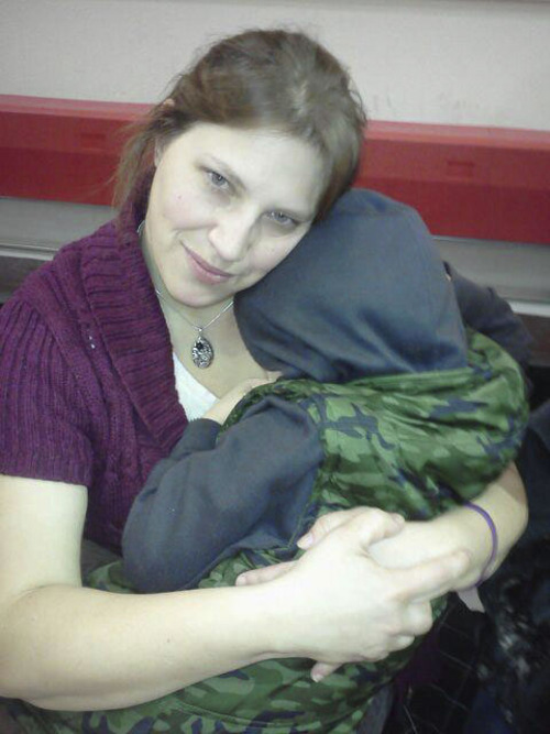 Courtesy photo Denise Cox comforts her nephew Braden Powell at a basketball game in Washington in 2011. Braden Powell, 5, died on Feb. 5, 2012, along with his brother, Charlie, 7. The boys' father,  36-year-old Josh Powell, attacked them with a hatchet and set fire to his Graham-area rental home. All three perished inside. At the time, Powell was locked in a bitter custody dispute with his in-laws and things weren't working out in his favor in court. He wrote in a suicide message that he couldn't live without his boys.  Memorials are planned to commemorate the first anniversary of the boys' deaths.