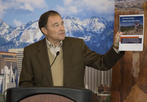 Paul Fraughton  |  The Salt Lake Tribune Utah Gov. Gary Herbert holds up a copy of Utah's Outdoor Recreation Vision he unveiled at a press conference Wednesday, January 23, 2013