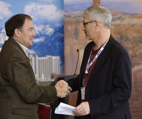 Paul Fraughton  |  The Salt Lake Tribune Gov. Gary Herbert shakes hands with president and CEO of the Outdoor Industry Association, Frank Hugelmeyer, at a press conference where the state's Outdoor Recreation Vision was unveiled.   Wednesday, January 23, 2013