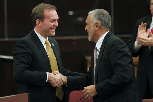 Al Hartmann  |  The Salt Lake Tribune Salt Lake County Mayor Ben McAdams, left, shakes hands with Salt Lake County Attorney Sim Gill before giving his first State of the County speech Tuesday, Feb. 5, 2013, in the Salt Lake County Council chambers.