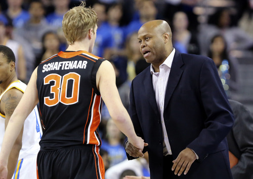 Oregon State head coach Craig Robinson, right, talks with forward Olaf Schaftenaar, of the Netherlands, in the first half of an NCAA college basketball game against UCLA in Los Angeles, Thursday, Jan. 17, 2013. UCLA won 74-64. (AP Photo/Reed Saxon)
