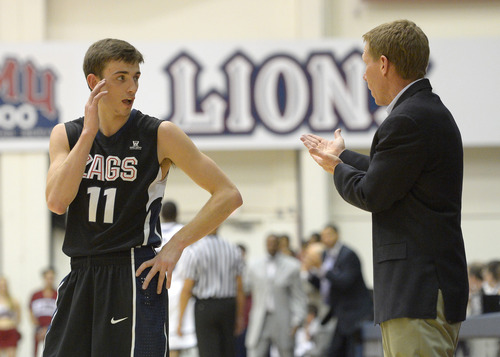 Gonzaga guard David Stockton, left, talks with head coach Mark Few during the second half of their NCAA college basketball game against Loyola Marymount. (AP Photo/Mark J. Terrill)
