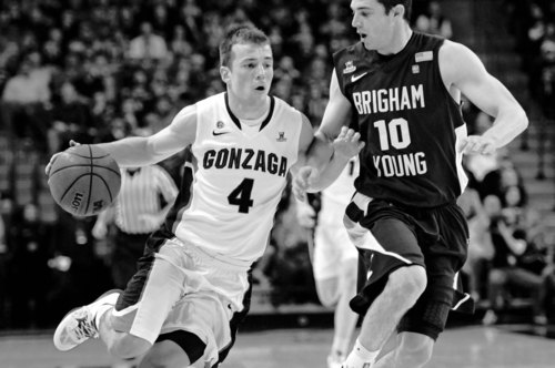 Bringham Youngs's Matt Carlino (10) had his hands full with Gonzaga's Kevin Pangos (4) last month in Spokane. The Zags pounded BYU that night. Cougar coach Dave Rose hopes his team will fare better in the Marriott Center rematch. (AP Photo/Jed Conklin)