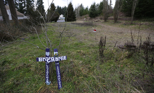 Two crosses placed in memory of Charlie and Braden Powell are shown Tuesday, Feb. 5, 2013, at the vacant lot in Graham, Wash., where a home once stood that was rented by the boys' father, Josh Powell, when he killed Charlie and Braden along with himself on Feb. 5, 2012. Powell also was a suspect in the disappearance of his wife Susan Cox Powell in 2009 in Utah. (AP Photo/Ted S. Warren)