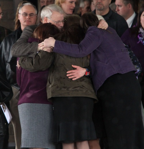 Rick Egan  | The Salt Lake Tribune  Chuck Cox and other family members join in a group hug after the funeral for Charlie and Braden Powell at the Life Center Church in Tacoma Saturday.