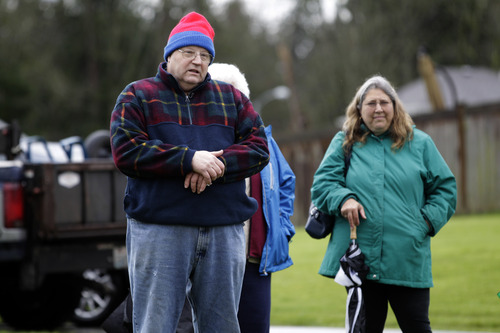 Chuck, left, and Judy Cox, right, view a newly installed memorial to people who have suffered the loss of a child, Monday Dec. 3, 2012, at Woodbine Cemetery in Puyallup, Wash. The memorial is near where their grandsons, Charlie and Braden Powell, were buried after their father, Josh Powell, killed them and himself earlier in 2012 during an investigation into the disappearance of Josh's wife, Susan. The memorial was paid for with funds donated to Crime Stoppers of Tacoma/Pierce County following the death of the boys. (AP Photo/Ted S. Warren)