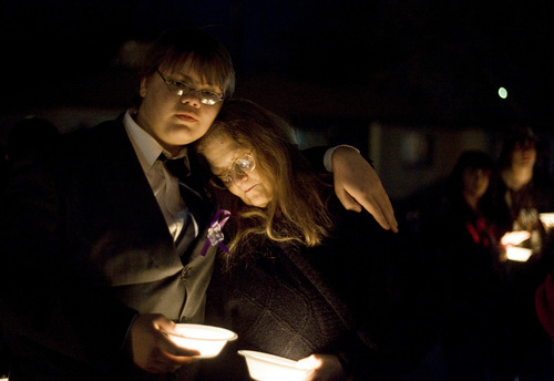 Kim Raff |The Salt Lake Tribune (left) Mathew (cq) Owings stands with his mother JoVonna (cq) Owings at a vigil for the Powell family after the explosion at Josh Powells house that kill himself and his two sons, Charlie and Braden, at Oquirrh Hills Elementary in Kearns, Utah on February 5, 2012. JoVonna Owings was a friend to Susan Powell and was the last person she talked to before she disappeared.