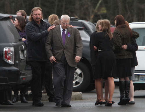 Rick Egan  |  The Salt Lake Tribune  Family members and friends comfort each other after the services in Puyallup, Wash., for Charlie and Braden Powell on Saturday.