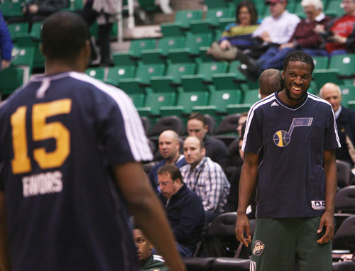 Steve Griffin | The Salt Lake Tribune   Utah's DeMarre Carroll, right, smiles at teammate Derrick Favors after knocking down a three pointer during warm-up prior to the Utah Jazz versus the Milwaukee Bucks basketball game at EnergySolutions Arena in Salt Lake City, Utah Wednesday February 6, 2013.