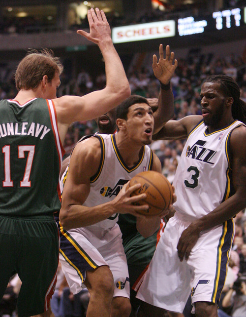 Steve Griffin | The Salt Lake Tribune   Utah's Enes Kanter goes tot he basket after ripping down an offensive rebound during first half action in the Utah Jazz versus the Milwaukee Bucks basketball game at EnergySolutions Arena in Salt Lake City, Utah Wednesday February 6, 2013.