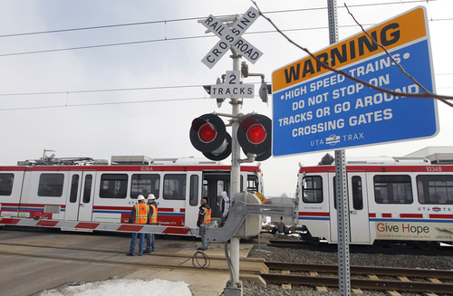 Al Hartmann  |  The Salt Lake Tribune South Salt Lake Police and UTA close intersection at 2950 South 200 West Wednesday morning February 6 to clear accident scene where a car was hit by a northbound TRAX train.