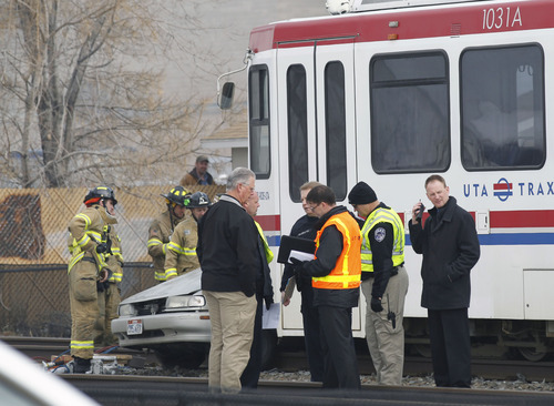 Al Hartmann  |  The Salt Lake Tribune South Salt Lake Police and UTA investigate an accident with a car and TRAX train at 2950 South 200 West Wednesday morning February 6 .