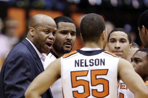 Oregon State head coach Craig Robinson, left, talks during a timeout in the first half of an NCAA college basketball game against Utah in Corvallis, Ore., Wednesday, Feb. 6, 2013. (AP Photo/Don Ryan)