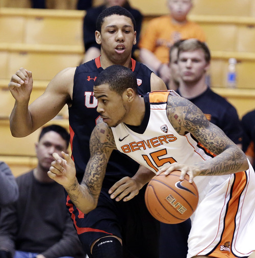 Oregon State forward Eric Moreland, right, drives past Utah forward Jordan Loveridge during the first half of an NCAA college basketball game in Corvallis, Ore., Wednesday, Feb. 6, 2013. (AP Photo/Don Ryan)