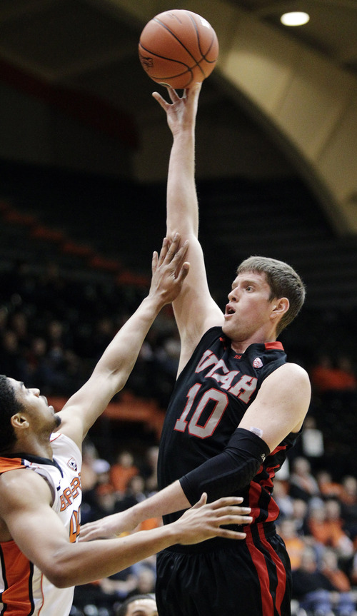 Utah forward Renan Lenz (10) shoots over Oregon State forward Devon Collier during the first half of an NCAA college basketball game in Corvallis, Ore., Wednesday, Feb. 6, 2013.(AP Photo/Don Ryan)
