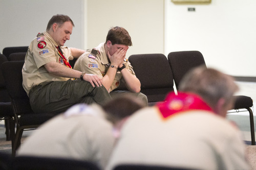 Scott Hines, scoutmaster for Troop 16 and his son Garrett, pray during a prayer vigil in the First Baptist Church Moores Lane in Texarkana, Texas on Tuesday, Feb. 5, 2013. Members of the troop, parents, and others prayed that the Boy Scouts of America would continue to keep their policy of excluding gay scouts and scoutmasters. The national executive board of the BSA began closed meetings on Monday to discus the policy. (AP Photo/Texarkana Gazette, Adam Sacasa)