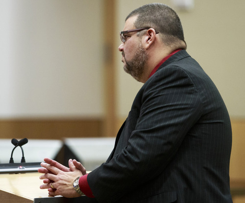 Defense Attorney Kirk Nurmi  questions defendant Jodi Arias q) as she testifies during her murder trial in Phoenix Tuesday, Feb. 5, 2013  Arias is accused of murdering her lover, Travis Alexander.   (AP Photo/The Arizona Republic, Charlie Leight)