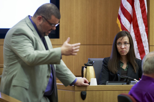 Defense attorney Kirk Nurmi questions defendant Jodi Arias about her relationship with Travis Alexander during her trial at Judge Sherry Stephens' Superior Court, on Wednesday, Feb. 6, 2013.  Arias, 32, is accused of stabbing and slashing Alexander, 27 times, slitting his throat and shooting him in the head in his suburban Phoenix home in June 2008. She initially denied any involvement, then later blamed it on masked intruders before eventually settling on self-defense.  (AP Photo/The Arizona Republic, Charlie Leight)