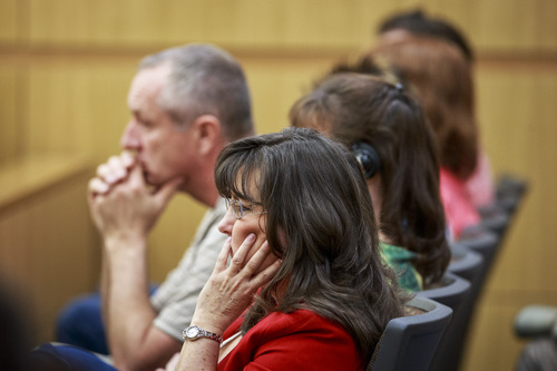 Jodi Arias' family members listen as Jodi talks about her relationship with Travis Alexander as she testifies in her murder trial in Judge Sherry Stephens' Superior Court, on Wednesday, Feb. 6, 2013.  Arias, 32, is accused of stabbing and slashing Alexander, 27 times, slitting his throat and shooting him in the head in his suburban Phoenix home in June 2008. She initially denied any involvement, then later blamed it on masked intruders before eventually settling on self-defense.  (AP Photo/The Arizona Republic, Charlie Leight)