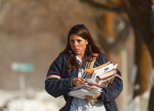 Trent Nelson  |  The Salt Lake Tribune US Postal Service letter carrier Ginny Shlemon delivers mail Wednesday, February 6, 2013 in Salt Lake City.