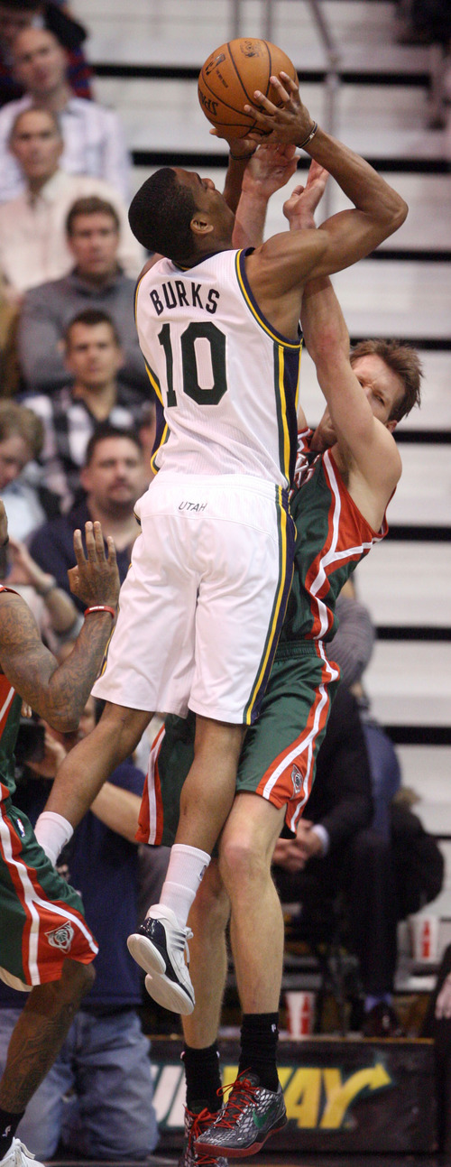 Steve Griffin | The Salt Lake Tribune   Utah's Alec Burks shoots over Milwaukee's Mike Dunleavy during second half action in the Utah Jazz versus the Milwaukee Bucks basketball game at EnergySolutions Arena in Salt Lake City, Utah Wednesday February 6, 2013.