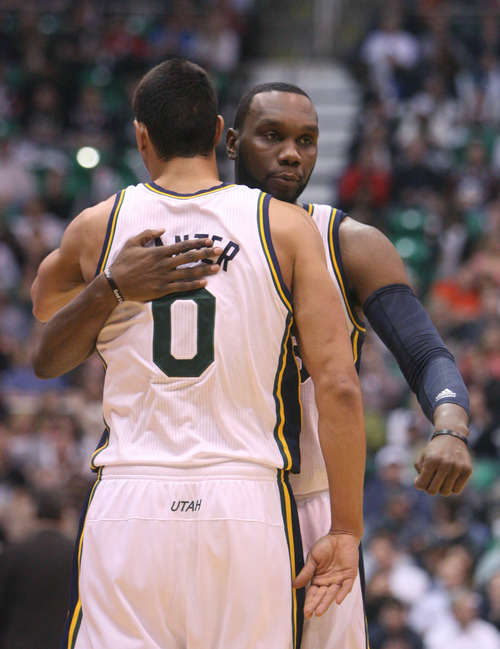 Steve Griffin | The Salt Lake Tribune   Utah's Enes Kanter gets a hug from Al Jefferson after as he heads to the bench during first half action in the Utah Jazz versus the Milwaukee Bucks basketball game at EnergySolutions Arena in Salt Lake City, Utah Wednesday February 6, 2013.