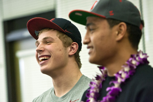 Chris Detrick  |  The Salt Lake Tribune Sean Barton and Filipo Mokofisi pose for pictures after signing their letter of intent at Woods Cross High School on National Signing Day Wednesday February 6, 2013. Barton will be playing football at Stanford and Mokofisi will be playing football at University of Utah.