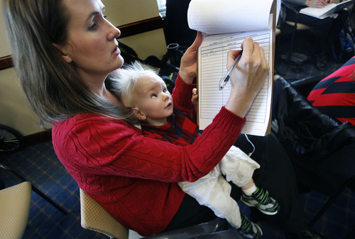 Scott Sommerdorf   |  The Salt Lake Tribune Carlene Boden, of Pleasant Grove, signs in prior to a Senate committee, addressing SB55 – Insurance Coverage for Autism Spectrum Disorder - with her 15-month-old son, Brycen, in her lap, on Thursday. Boden has a 6-year-old daughter, Brianna, who has autism.