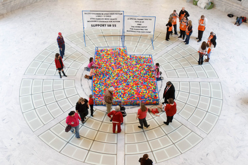 Trent Nelson     The Salt Lake Tribune Advocates for autism insurance reform placed a pit of 18,532 plastic balls, one ball for every autistic child in Utah, in the Capitol Rotunda on Friday.